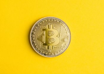 Golden bitcoins . Cryptocurrency on yellow background. Crypto money.
